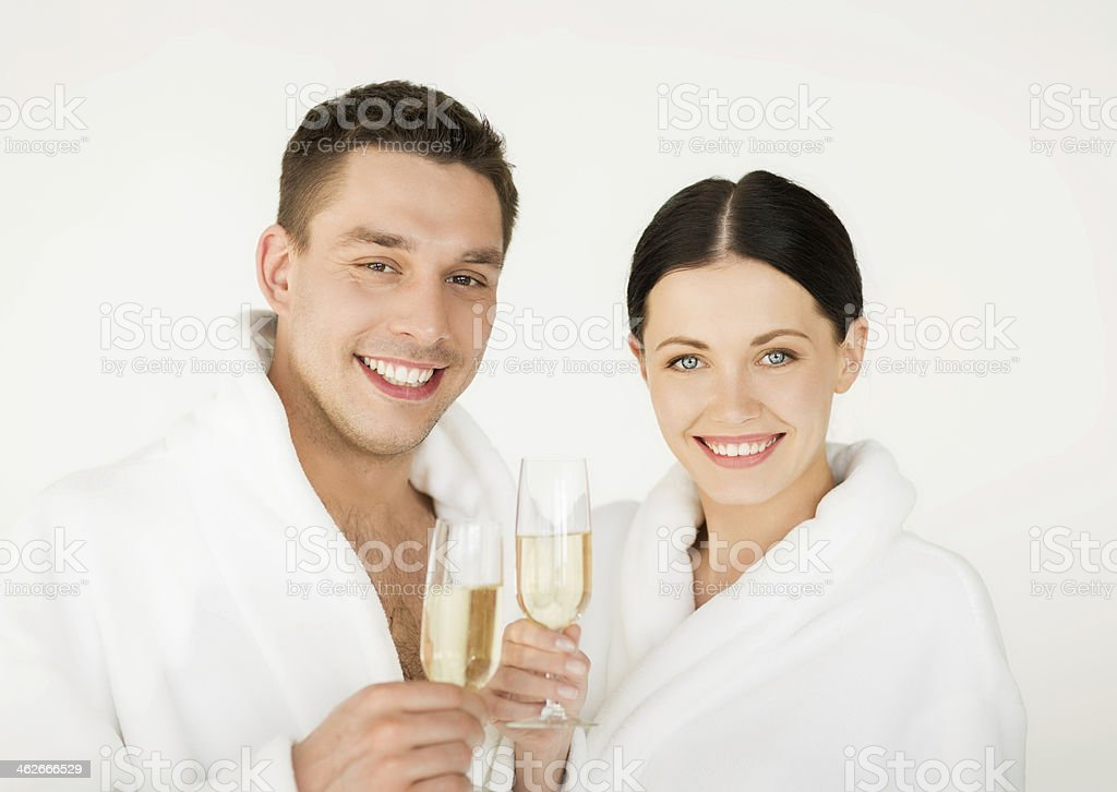 happy couple drinking champagne in hotel spa stock photo