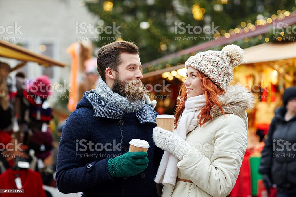 happy couple drinking coffee on old town street stock photo