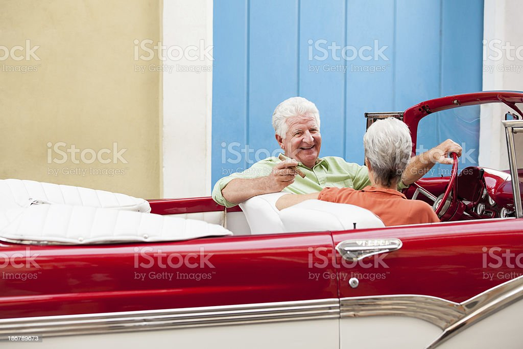 Happy couple driving a cuban classic car royalty-free stock photo