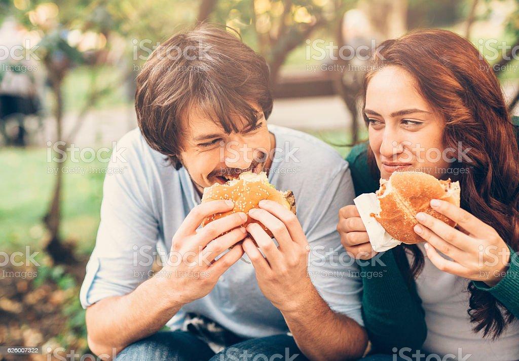 Happy couple eating stock photo