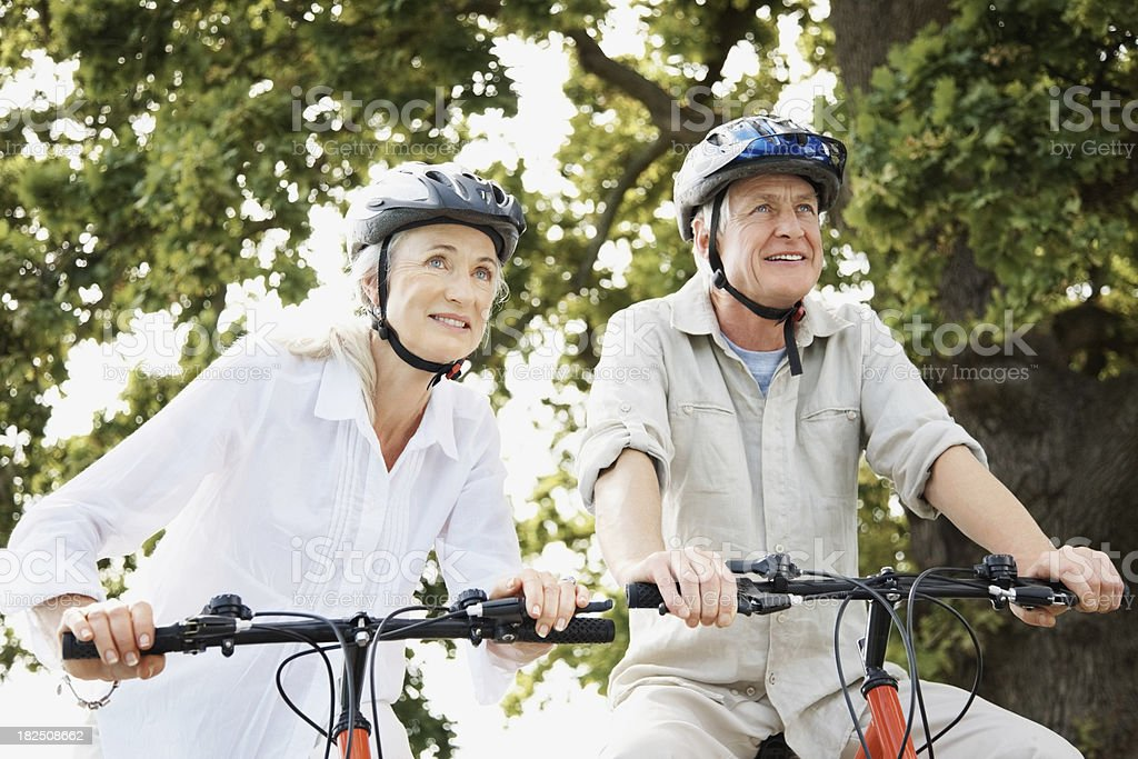 Happy couple enjoying a cycle ride together royalty-free stock photo