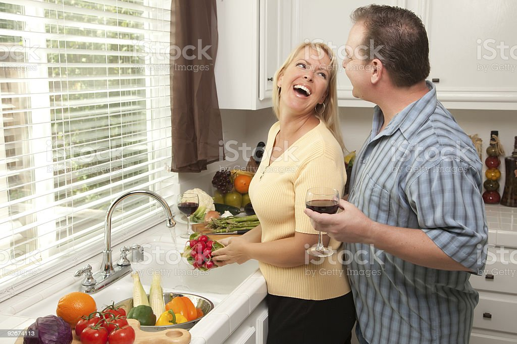 Happy Couple Enjoying An Afternoon in the Kitchen royalty-free stock photo