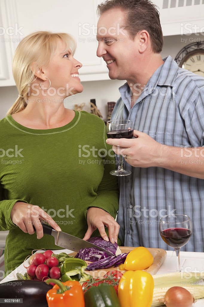 Happy Couple Enjoying An Evening in the Kitchen royalty-free stock photo