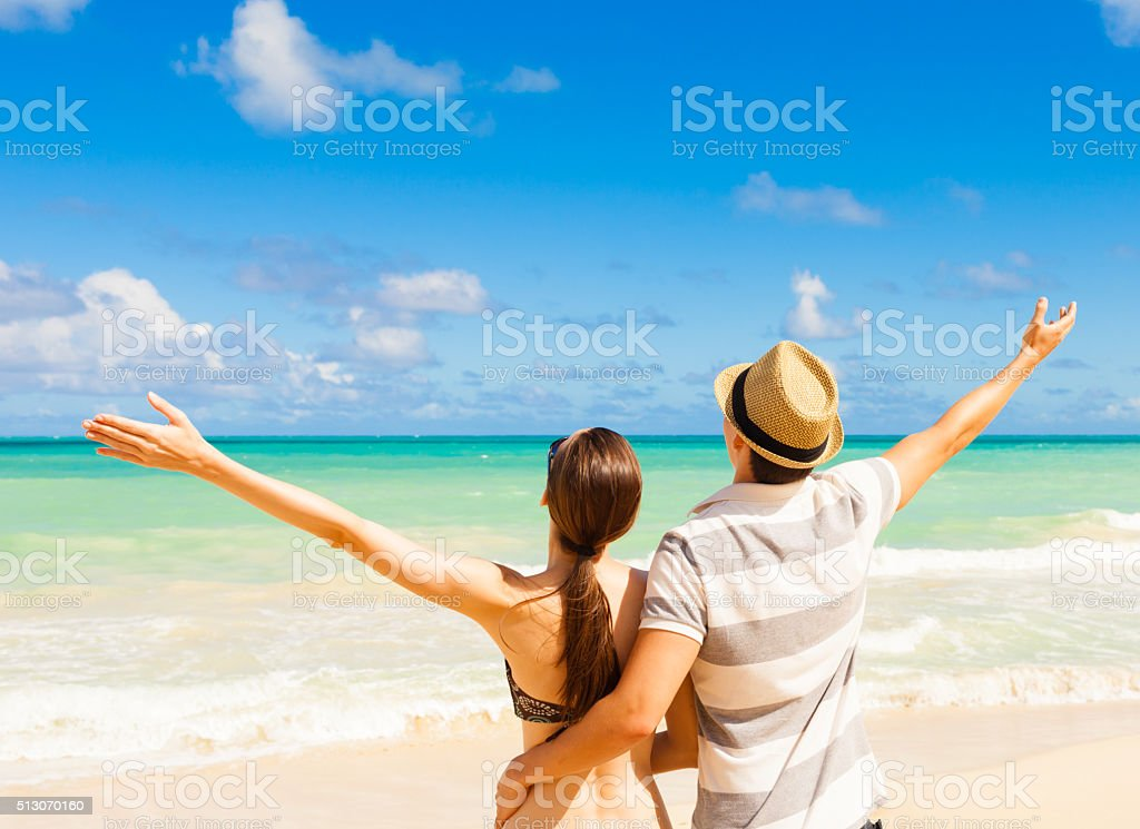 Happy couple enjoying summer beach stock photo
