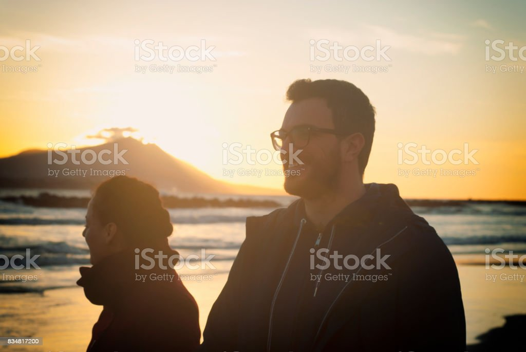 Happy couple enjoying the sunset stock photo