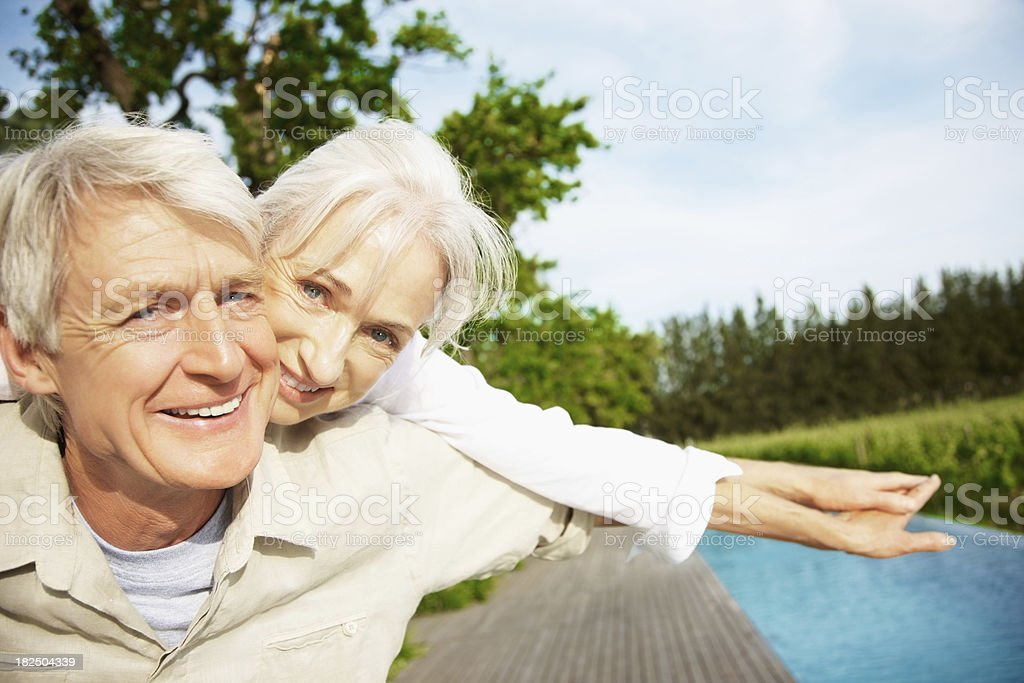 Happy couple enjoying their vacation by the pool royalty-free stock photo