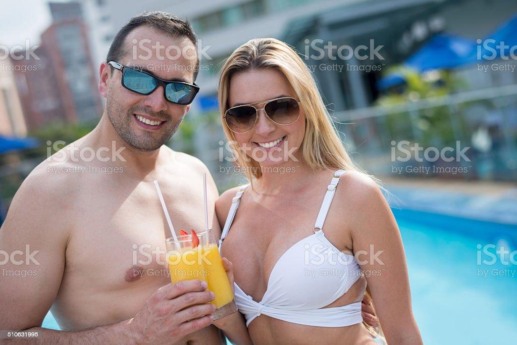 Happy couple enjoying their vacations stock photo