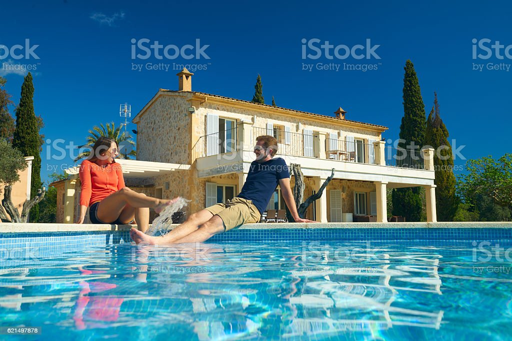 happy couple enjyoing their vacation on spanish finca stock photo