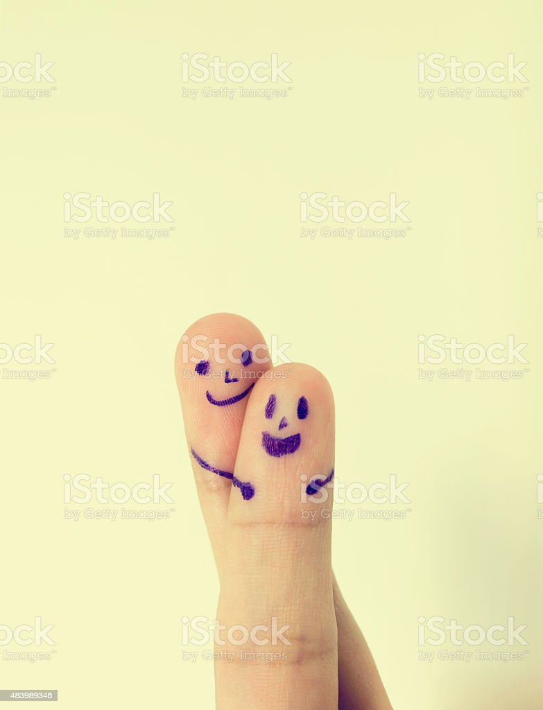 happy couple fingers in love a smiley. stock photo