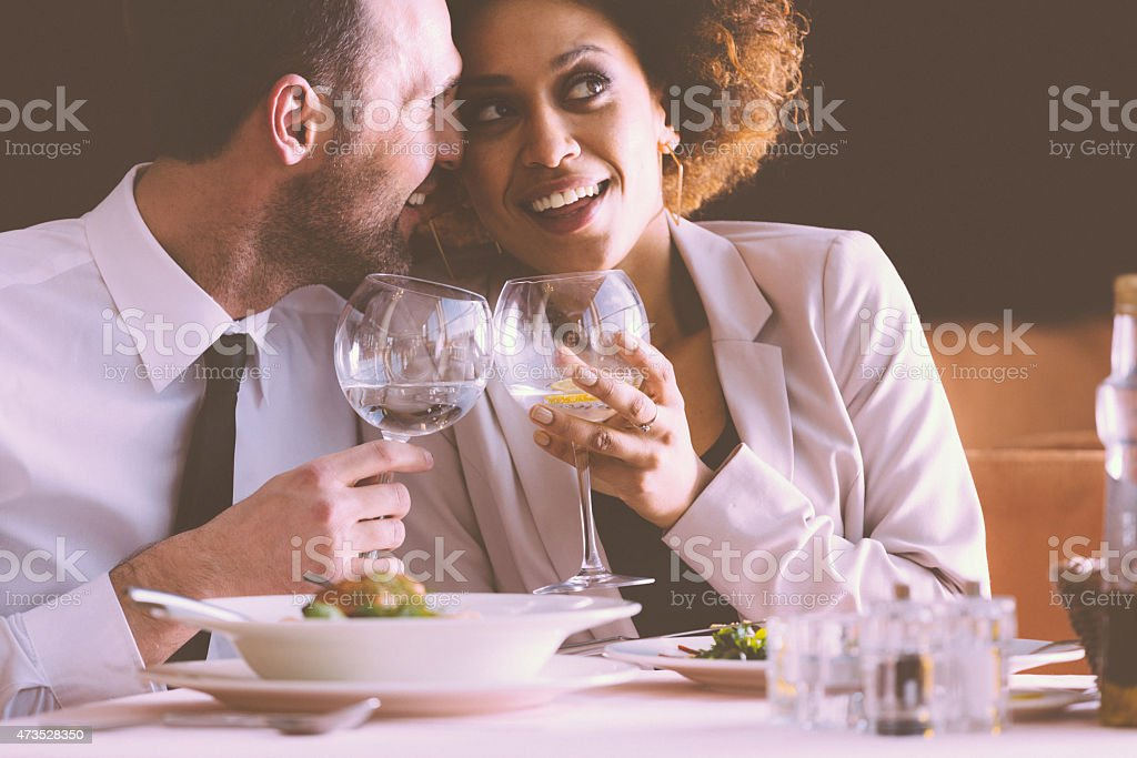 Happy couple flirting at dinner in the restaurant stock photo