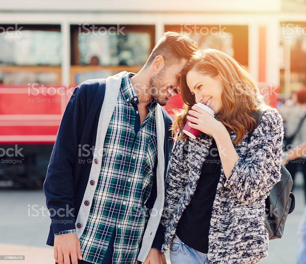 Happy couple flirting outside stock photo