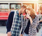 Happy couple flirting outside
