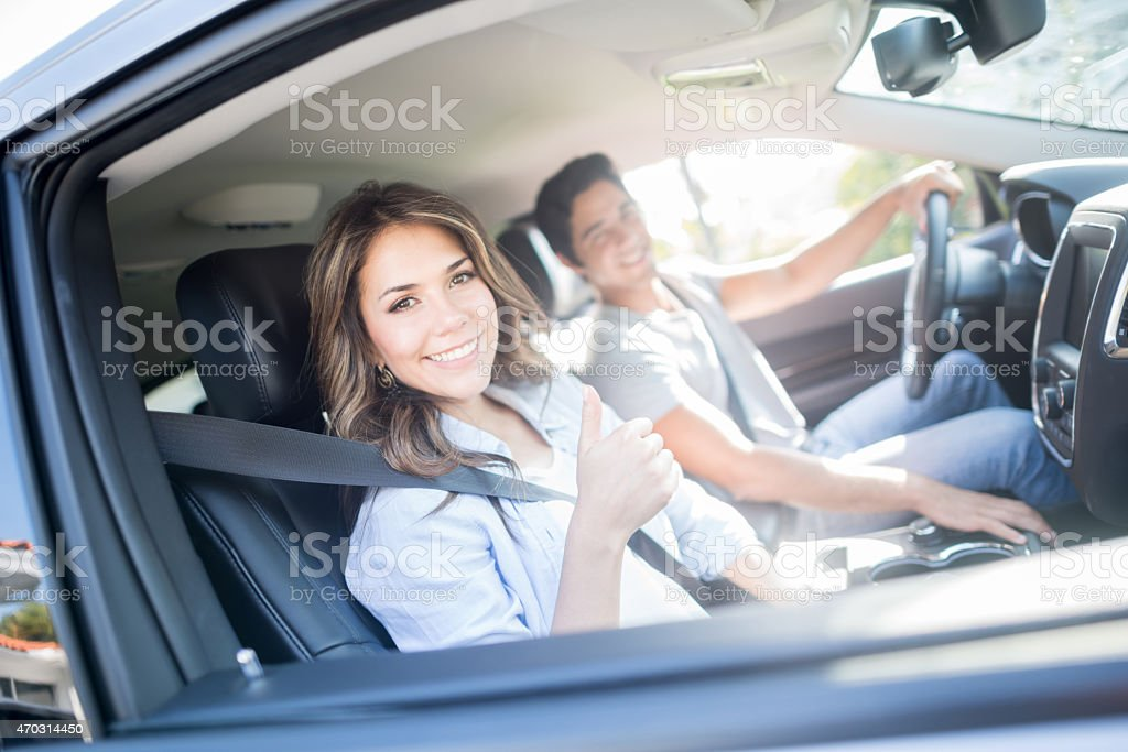 Happy couple going on a road trip stock photo