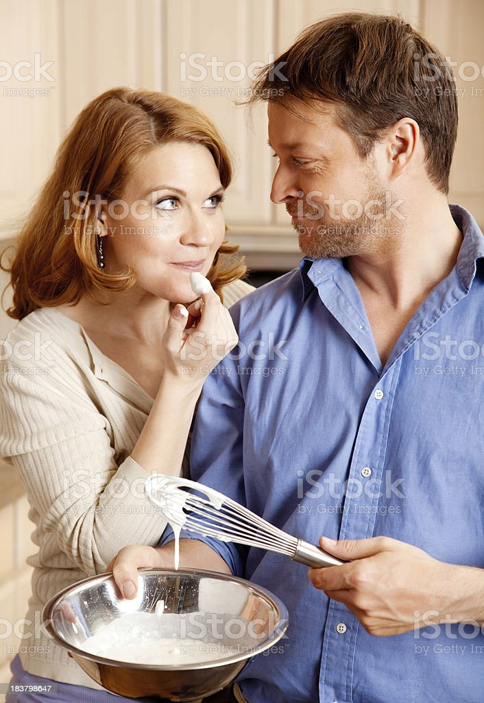 Happy Couple Having Fun in the Kitchen royalty-free stock photo