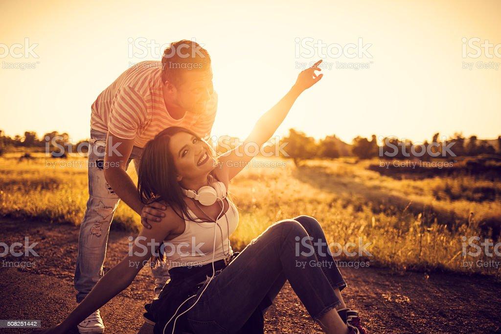 Happy couple having fun with skateboard stock photo