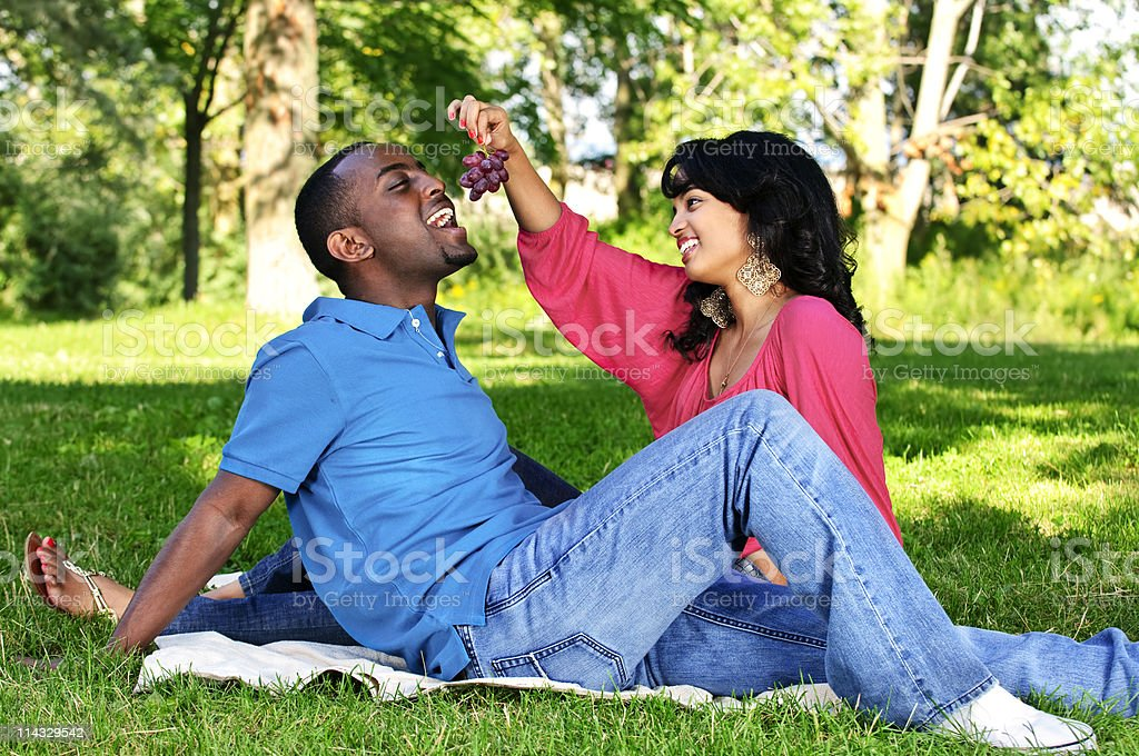 Happy couple having picnic in park royalty-free stock photo