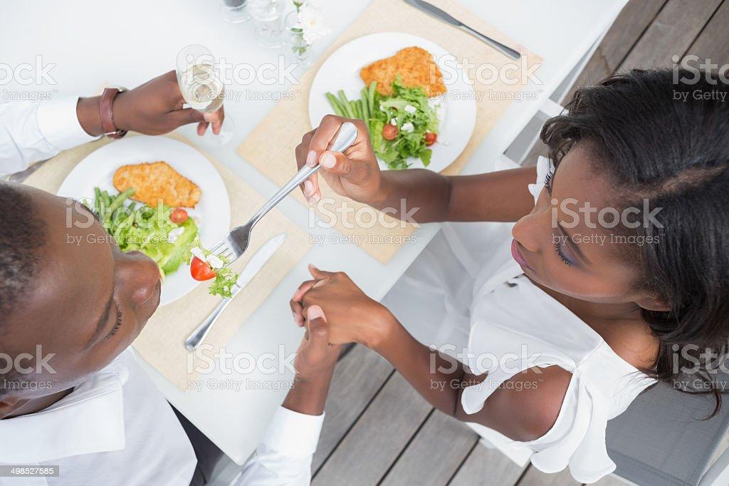 Happy couple having their lunch al fresco royalty-free stock photo