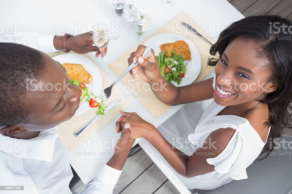 Happy couple having their lunch al fresco royalty-free stock photo