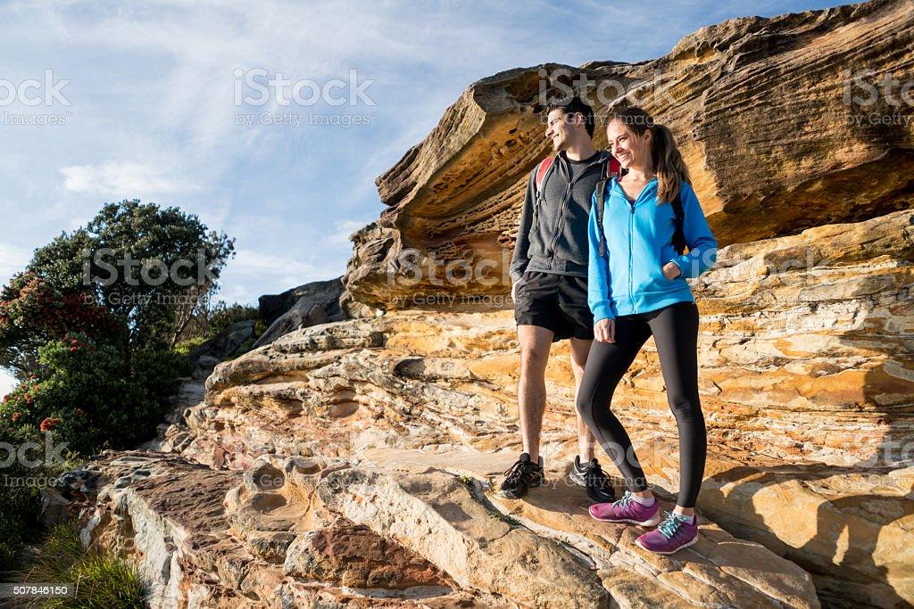 Happy couple hiking stock photo