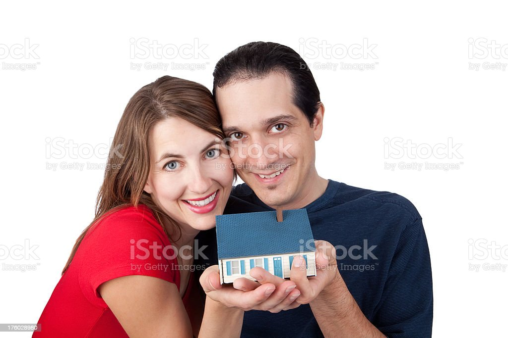 Happy Couple Holding A Small House royalty-free stock photo