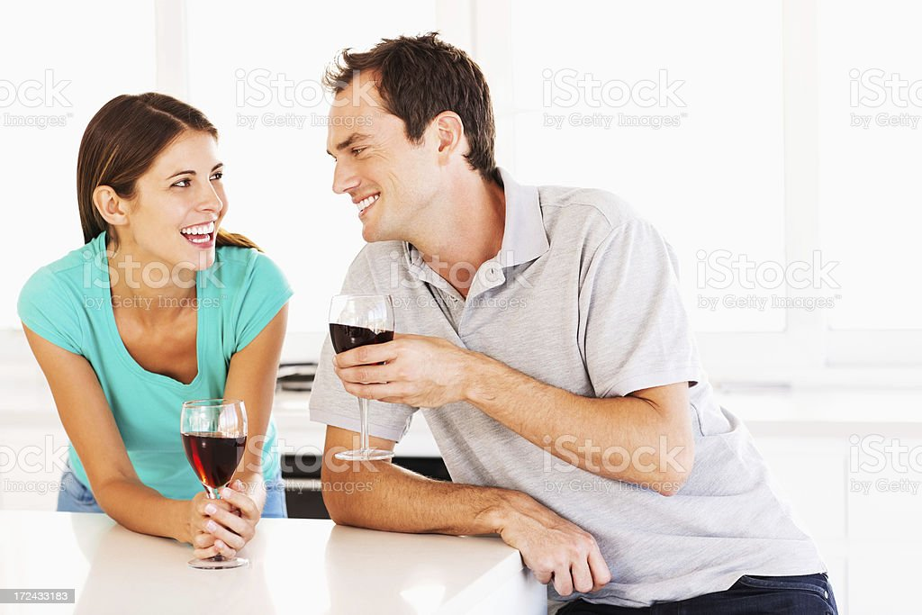 Happy Couple Holding Glasses Of Red Wine royalty-free stock photo