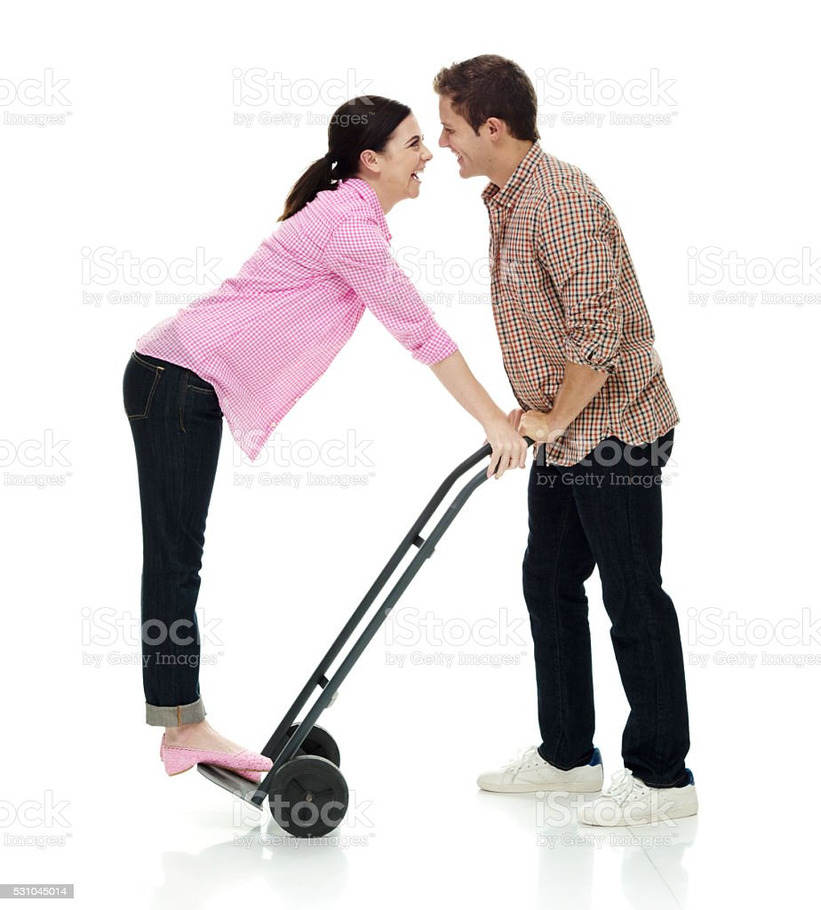 Happy couple holding hand truck stock photo