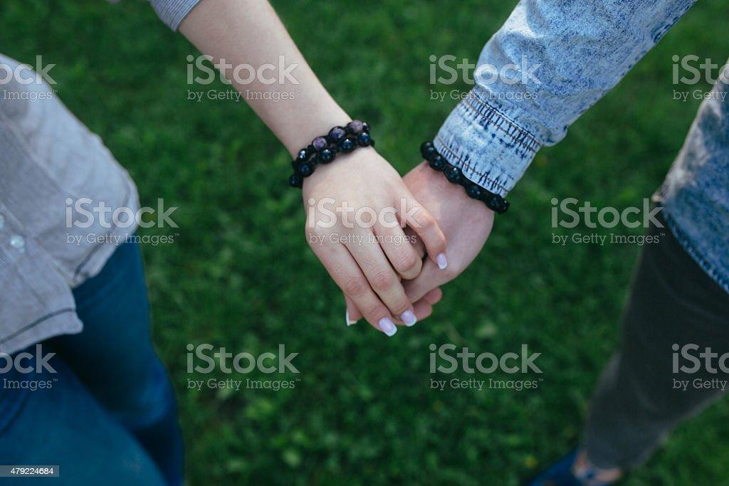 Happy couple holding hands stock photo