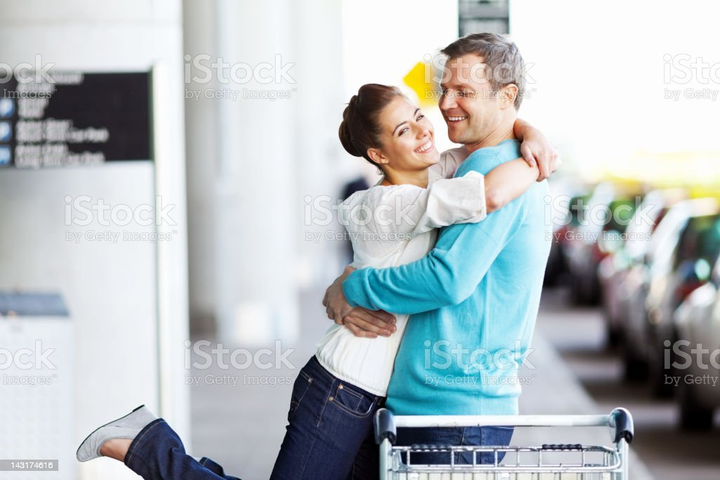 Happy Couple Hugging At The Airport royalty-free stock photo