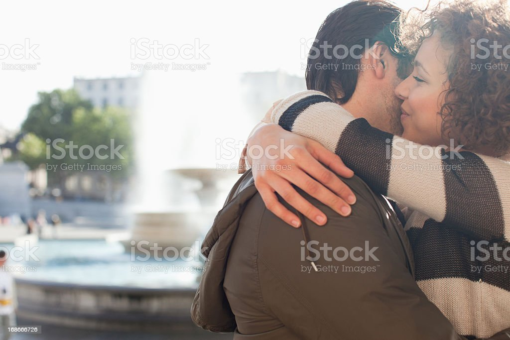 Happy couple hugging in city royalty-free stock photo