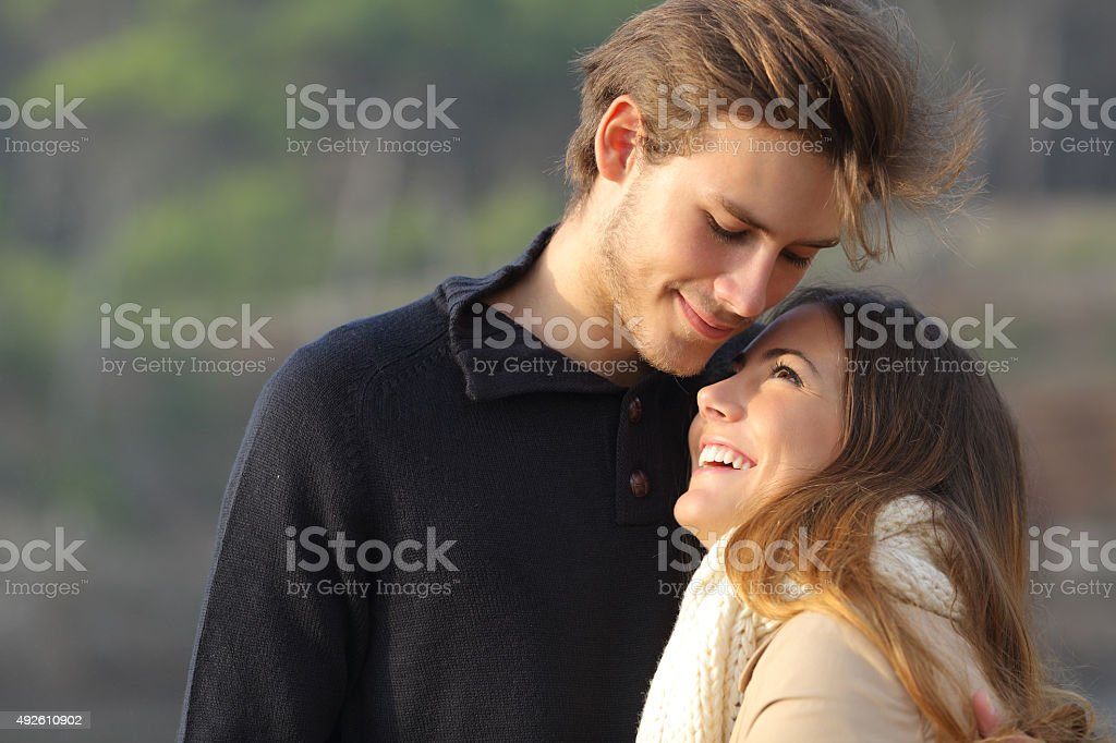 Happy couple hugging in love outdoors stock photo