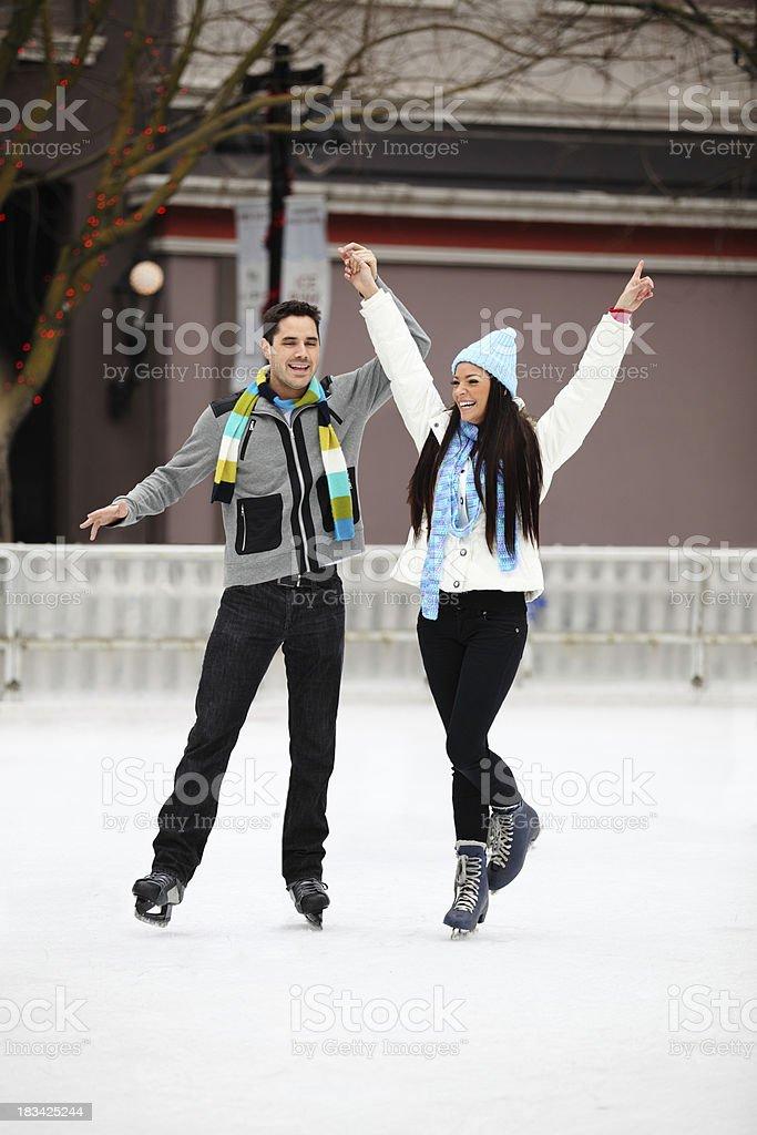 Happy Couple Ice Skating stock photo