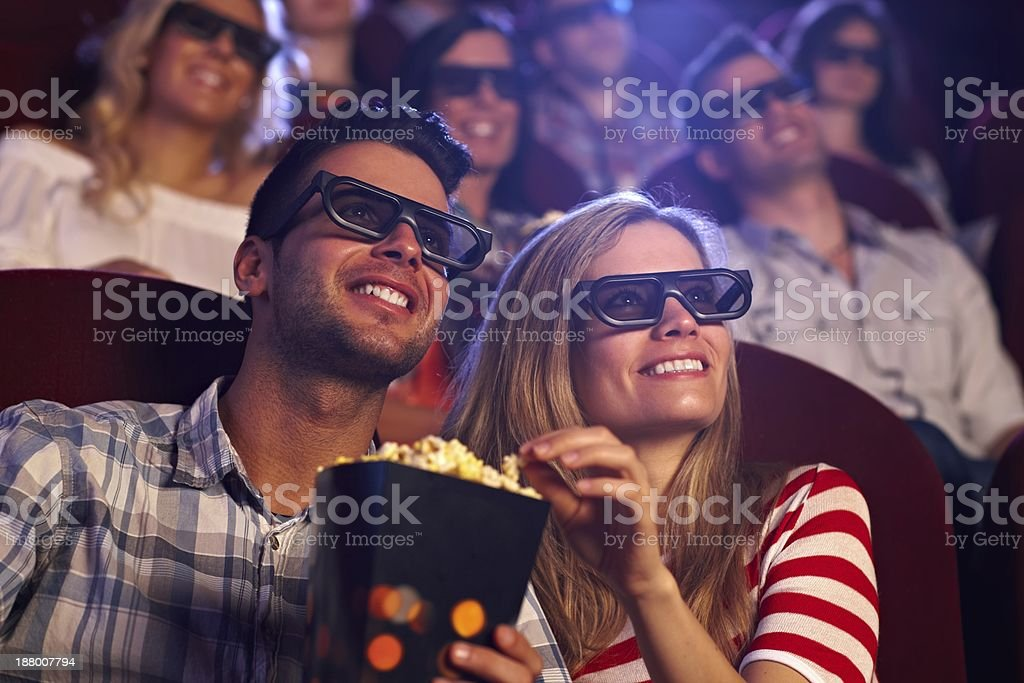 Happy couple in 3D movie stock photo