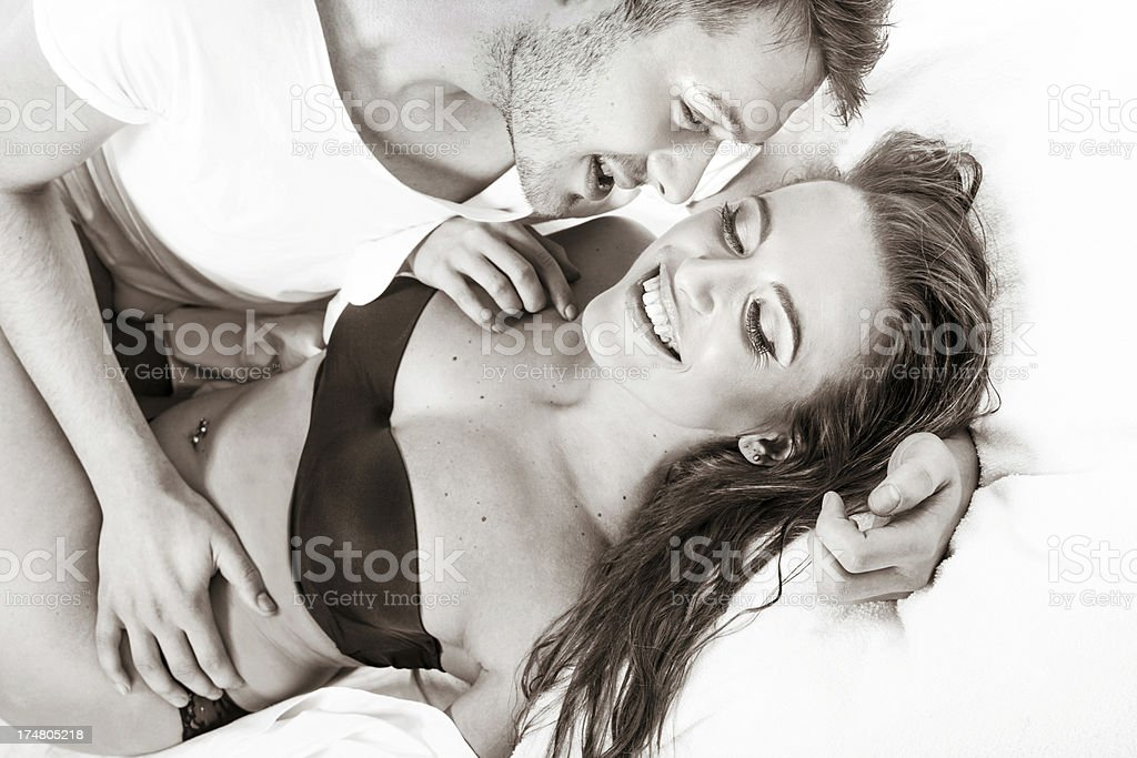 Happy couple in a bedroom royalty-free stock photo