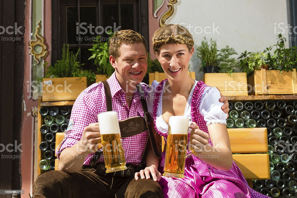 Happy Couple in Beer garden drinking royalty-free stock photo