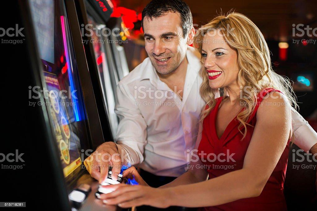 Happy couple in casino. stock photo