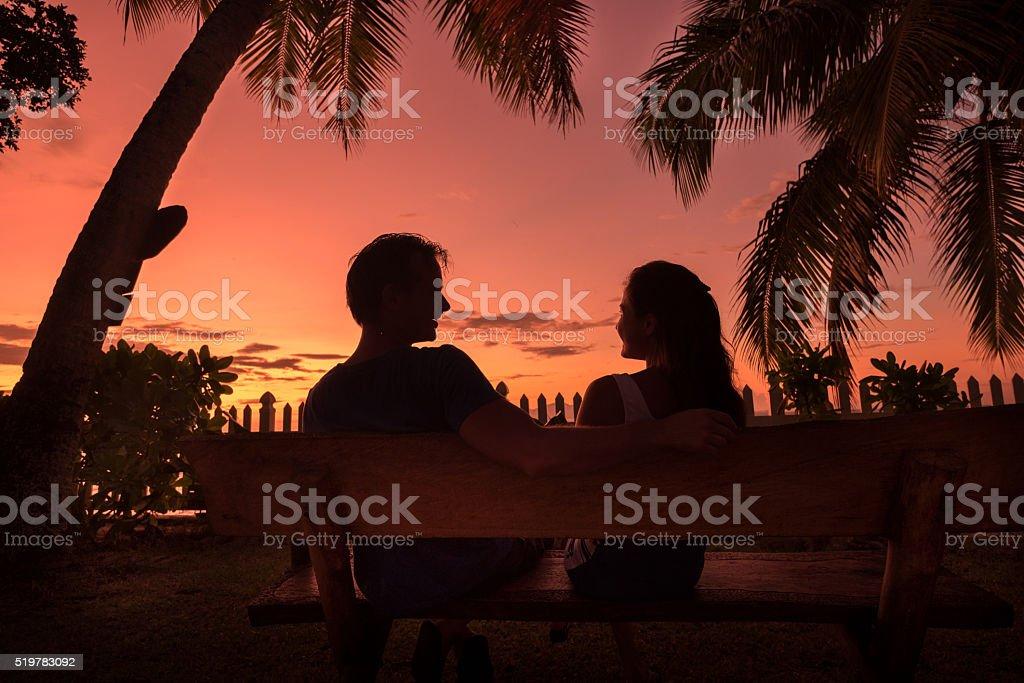 happy couple in exotic garden stock photo