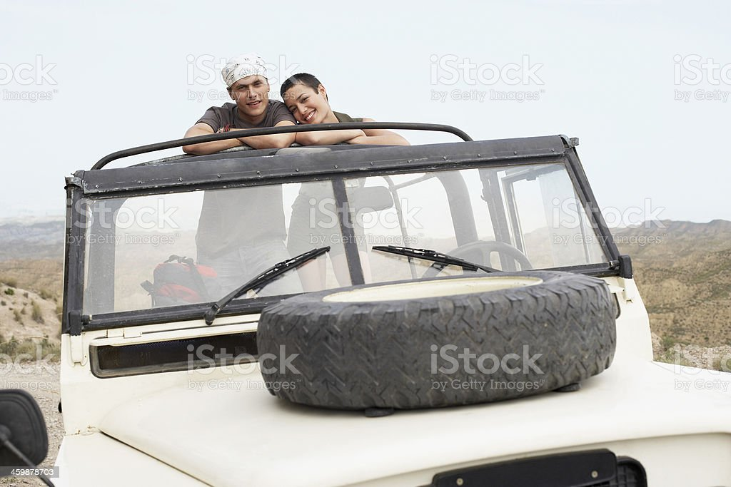 Happy Couple In Four-Wheel-Drive Car royalty-free stock photo