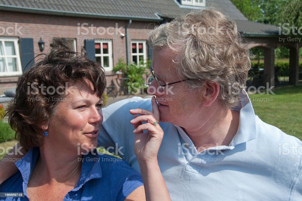 Happy couple in front of house stock photo