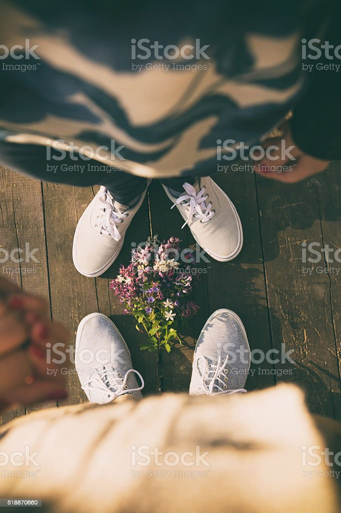 Happy couple in love holding hands. stock photo
