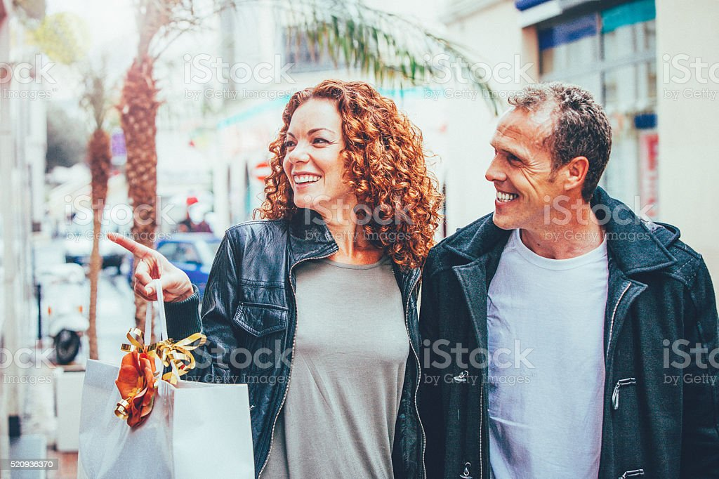 Happy couple in love shopping stock photo