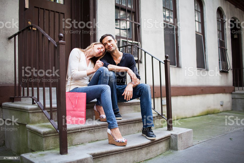 Happy couple in love sitting at door steps royalty-free stock photo