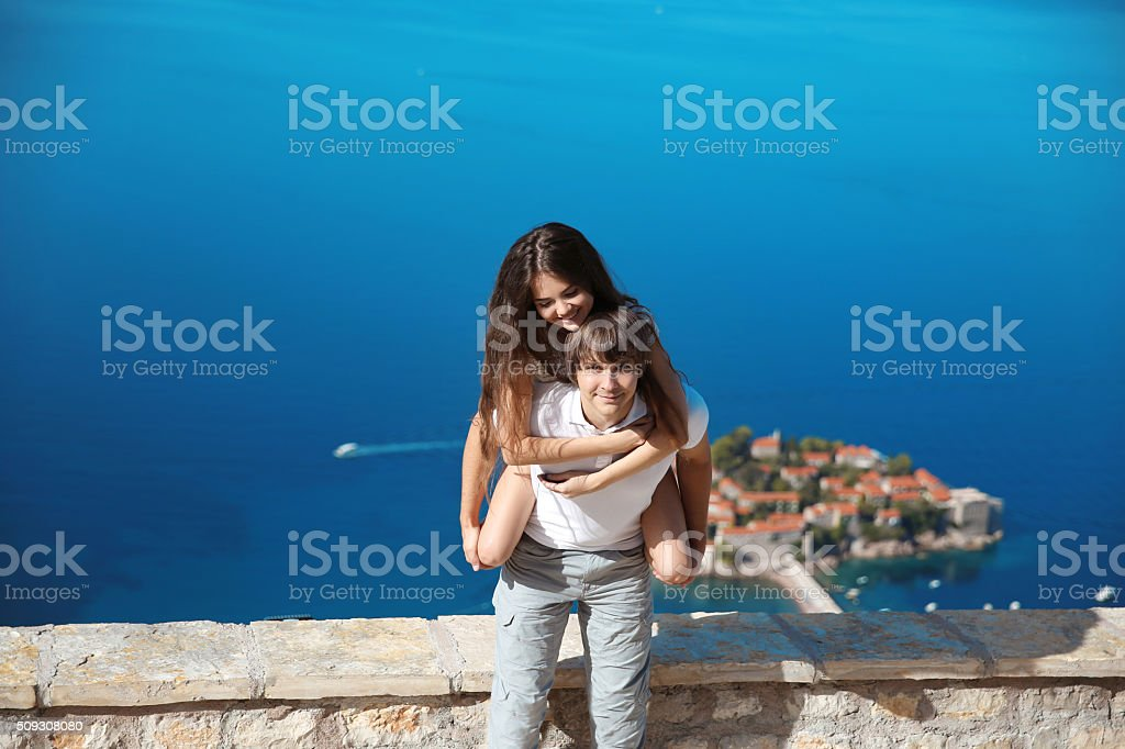 Happy couple in love summer vacations. Travel. Sveti Stefan stock photo