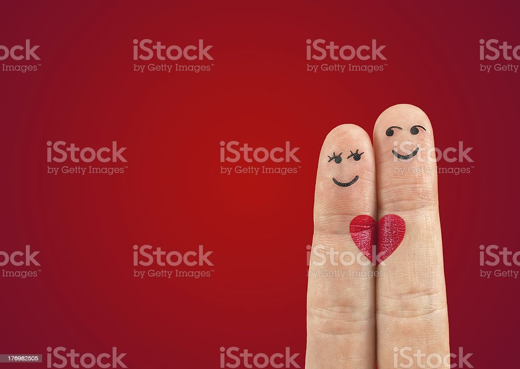 happy couple in love with painted smiley and hugging stock photo