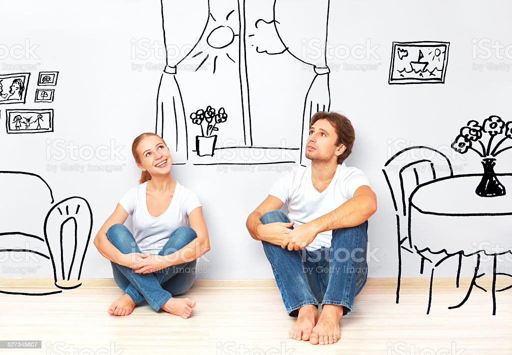 happy couple in  new apartment dream and plan interior stock photo