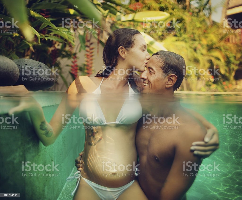 Happy couple in pool royalty-free stock photo