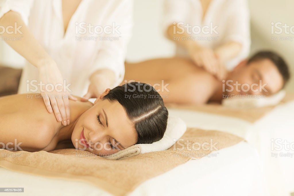 happy couple in spa salon having massage stock photo