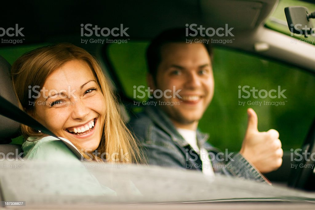 Happy couple in the car. royalty-free stock photo