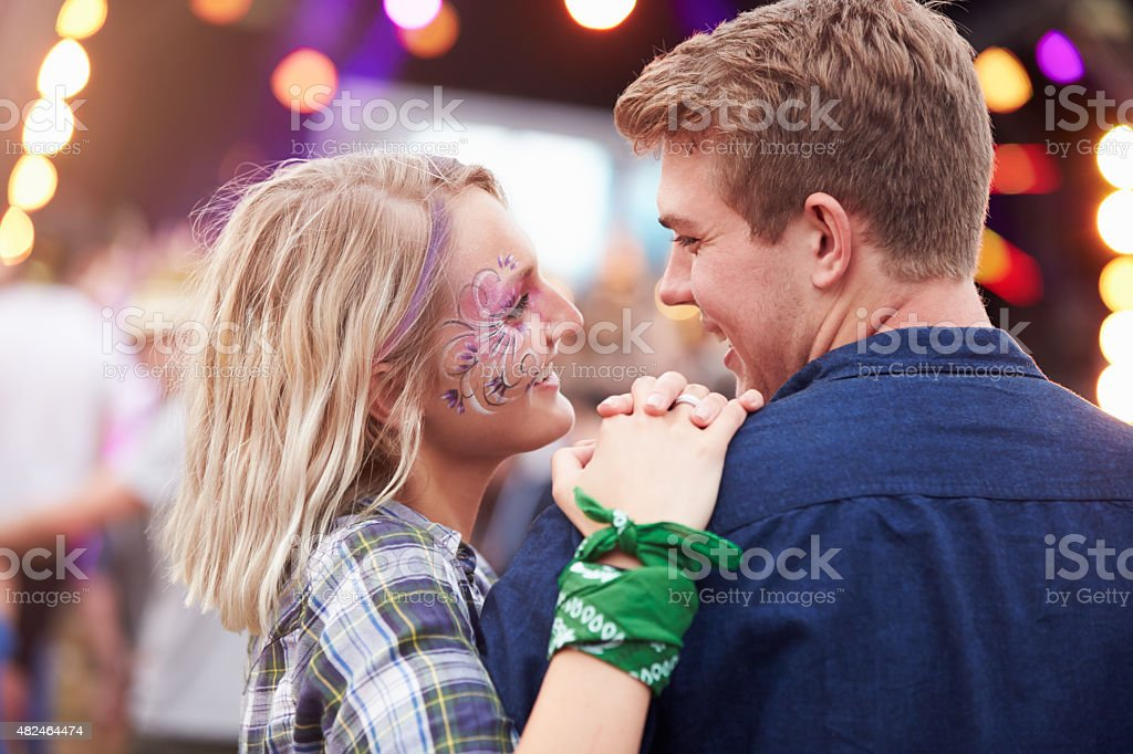 Happy couple in the crowd at a music festival stock photo