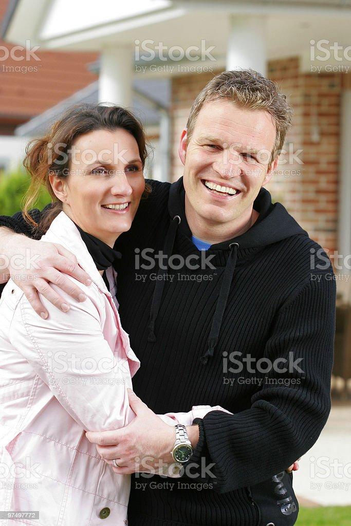 Happy couple in the garden stock photo