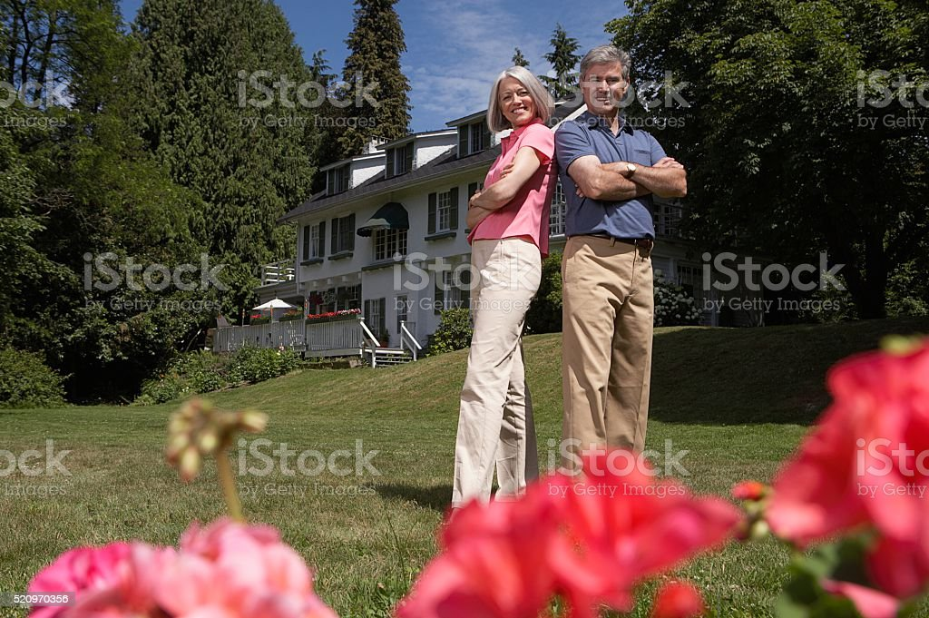Happy couple in their yard stock photo